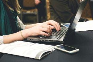 Woman Typing Writer